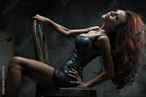 Sexy woman on the chair posing