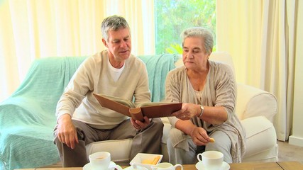 Mature couple looking at an album