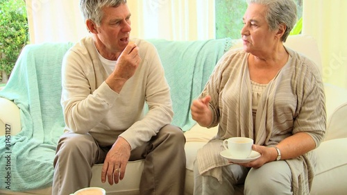 Couple chatting and drinking tea