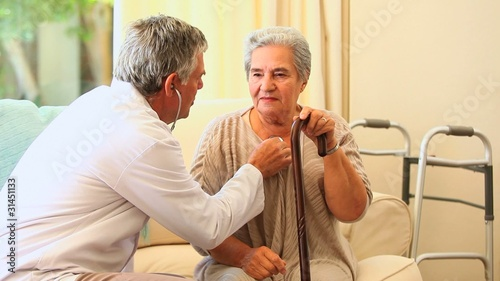 Doctor examining patient  with a stethoscope