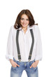 Young woman in jeans with suspenders