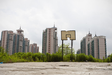 basketball court soon to be invaded by real estate development
