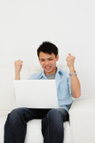 Excited man with laptop
