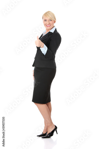 Mature businesswoman's gesticulating ok.