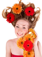 Happy young woman with tousled hair.