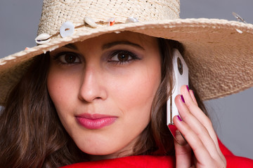 Young woman mobile phone STRAW HAT PORTRAIT