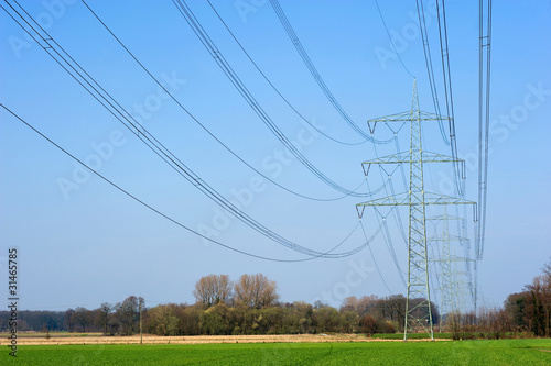Electricity transmission cables with blue sky on the background