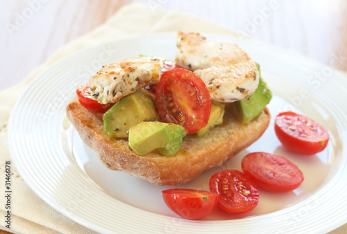 Tasty avocado, tomato and chicken bruschetta