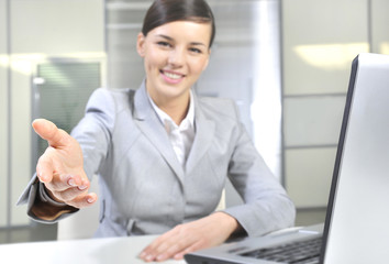 Happy businesswoman inviting to cooperation