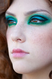 Fashion woman with green make-up at rural location poster