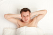 covering ears young handsome man in white bedding, series