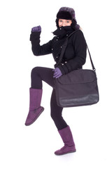 young woman in winter jacket and hat with laptop bag