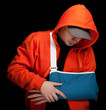 young man with broken hand wearing an arm brace