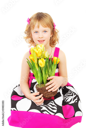 Little girl with spring flowers.