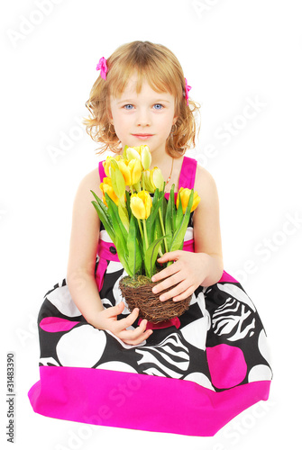 Little girl in fashion dresswith yellow flowers.