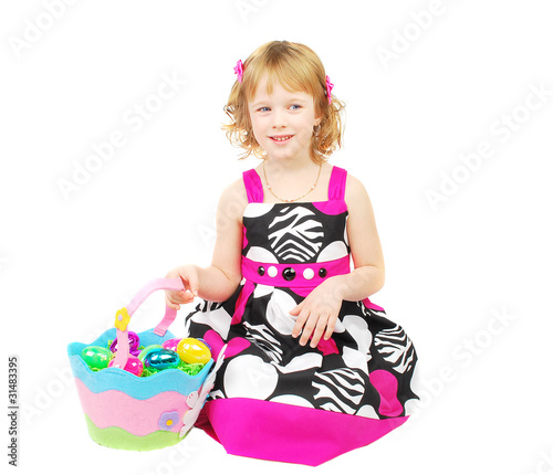 Little girl with Easter bascket.