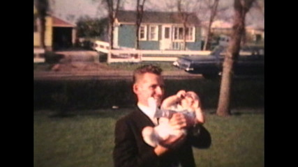 Proud Parents Holding Baby Outdoors (1963 - Vintage 8mm film)