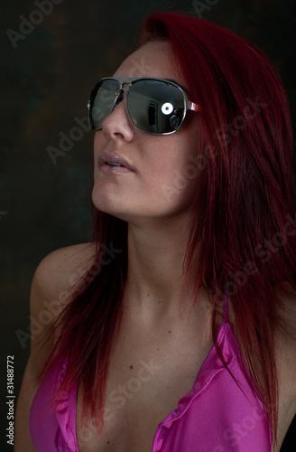 Pretty young woman in sunglasses