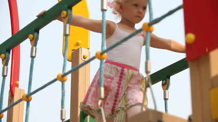 Little girl climbing ladder on playground