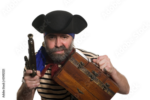 Pirate with a musket holding chest.