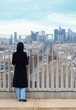 woman standing on Triumfaly arch and looking at La Defense