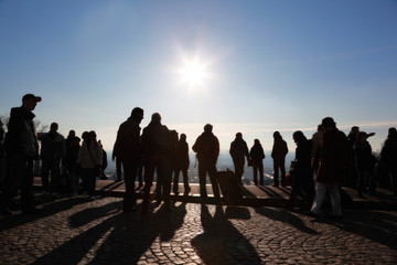 Tourists in Paris looking at panorama of city