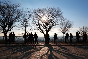 Tourists in Paris on observation platform looking at panorama