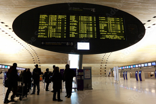 People standing near display board in airport - 31493955