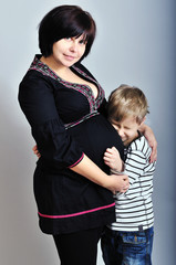 pregnant mother with older son