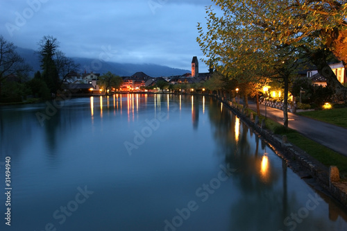 Switzerland, Interlaken. Evening view of a small river
