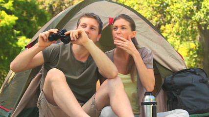 Loving couple camping in the country side