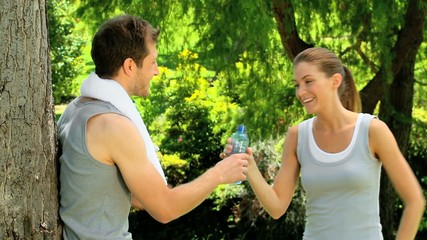 Athletic woman joining boyfriend after a jog