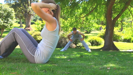 Athletic couple exercising outdoors