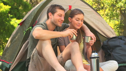Attractive couple camping in the country side