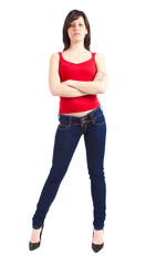 Young slim woman in jeans and red shirt isolated on white