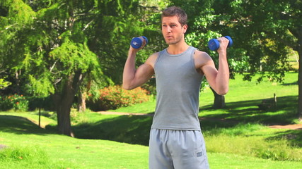 Dynamic man with dumbbells