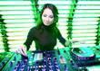 Attractive girl DJ in the nightclub