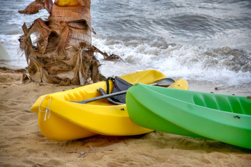Yellow and Green Kayaks Sitting on the Beach