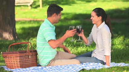 Lovers drinking red wine as an aperitif