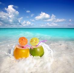 coconut cocktails juice in tropical beach water splash