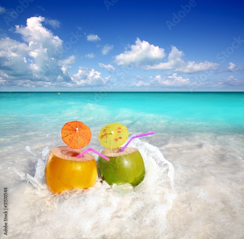 coconut cocktails juice in tropical beach water splash