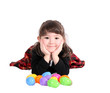 sweet girl laying with colourful easter eggs isolated