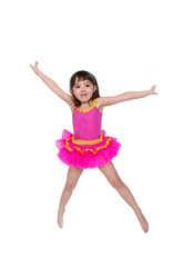adorable little girl in tutu jumping isolated