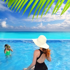 blue swimming pool caribbean view mother daughter