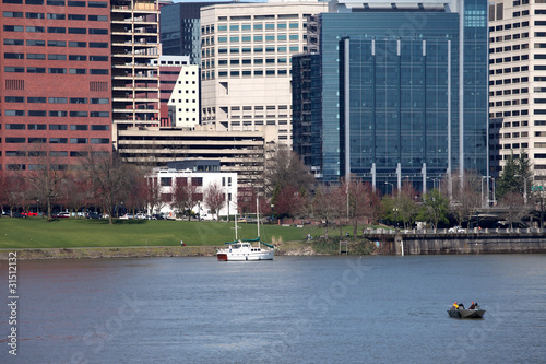 Portland Oregon downtown buildings & boats in a river.