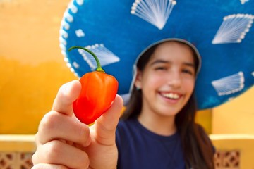 Mexican girl  habanero orange hot chili pepper