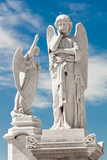 Two white angels with a beautiful sky background