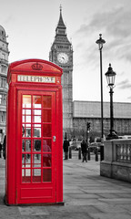 Red phone booth in London with the Big Ben in black and white © kmiragaya