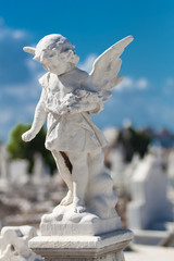 Child angel statue in a cemetery