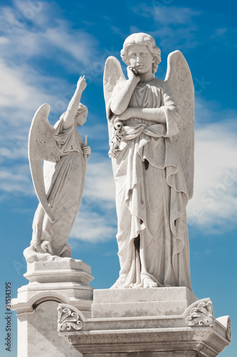 Two white angels with a beautiful sky background - 31514395